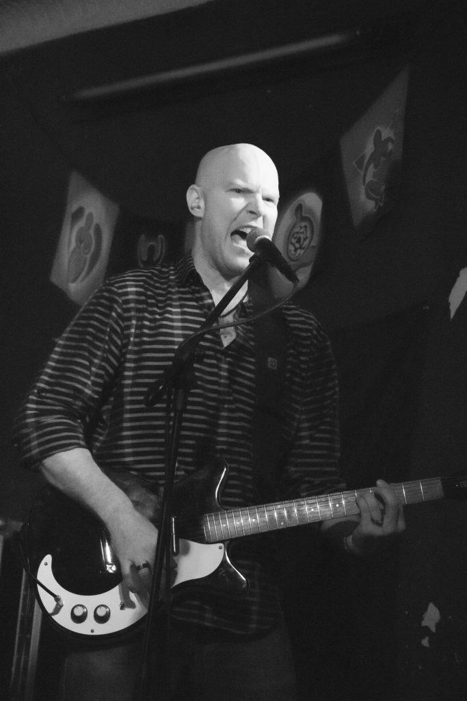 SB playing guitar and singing